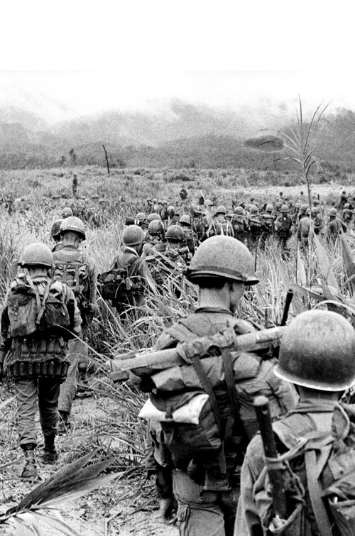 American soldiers marching in Vietnam, 1968