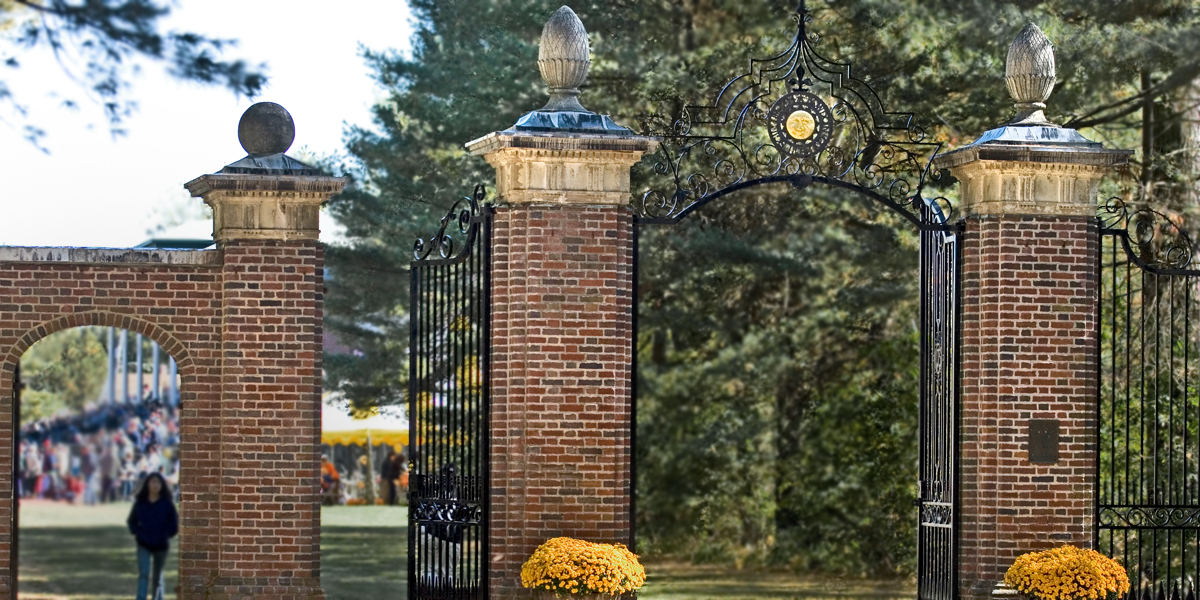 The gates to Whittier Field in autumn