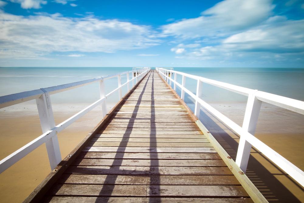 A beachside pier decorates this sample image.