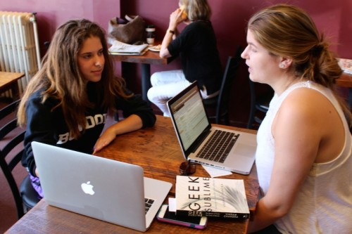 Gabriella Papper '18 (left) and Phoebe Bumsted '17 (right) are two of the four students doing research with Prof. Hall. They often meet in Little Dog Cafe in downtown Brunswick to work on their projects and bounce ideas off of one another.