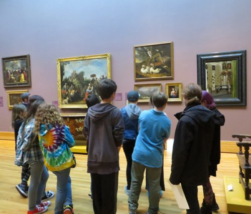 A school group enjoys a tour at the Bowdoin College Museum of Art.