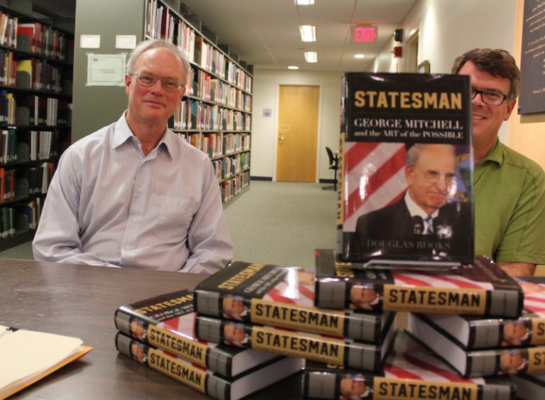 Doug Rooks, left, at a book signing at Hawthorne-Longfellow Library