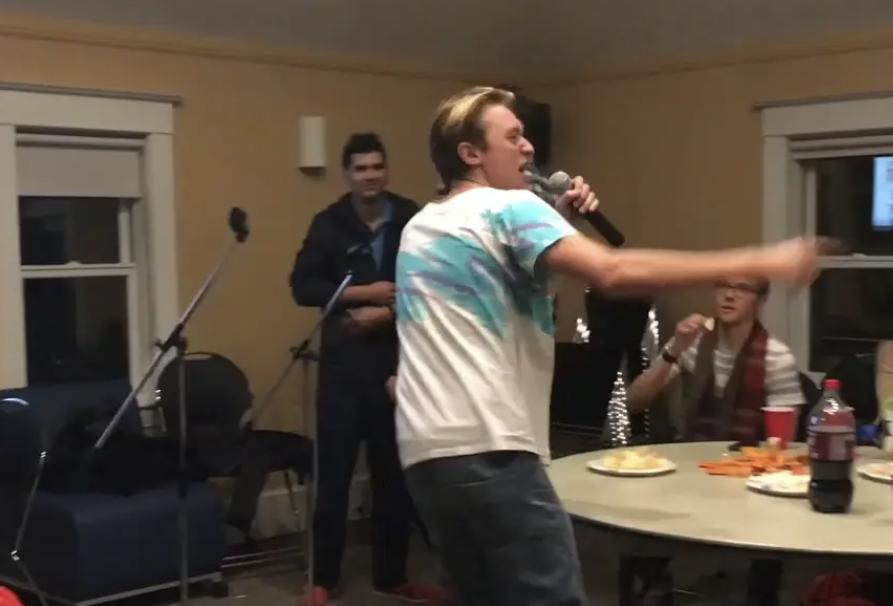 Student performing karaoke.