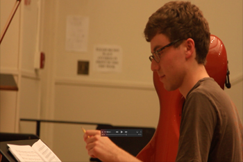student conducting music