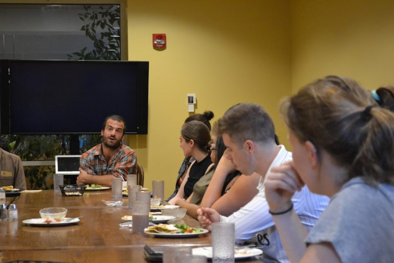 Willy Oppenheim '09 returned to Bowdoin to lead a discussion on international service
