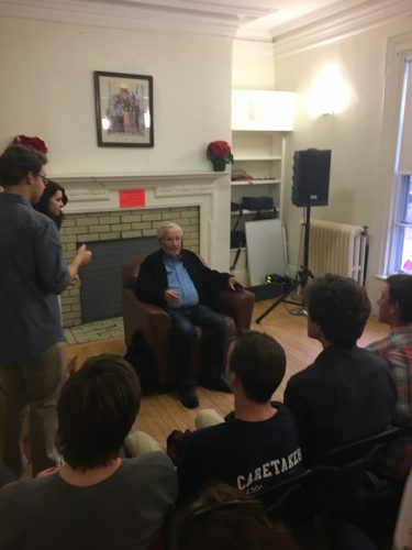 Noam Chomsky talks with students at Burnett House