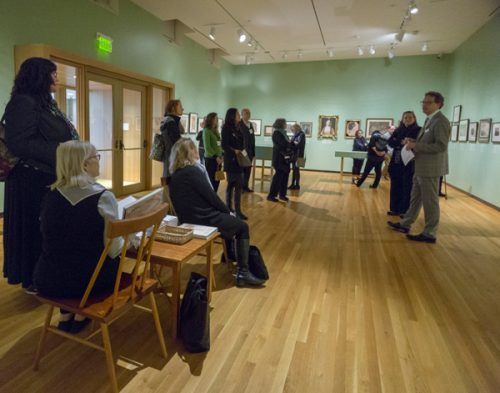 "Joachim Homann, curator, speaking to visitors in the exhibition ""Why Draw: 500 Years of Drawings and Watercolors at Bowdoin College"" at the Bowdoin College Museum of Art."