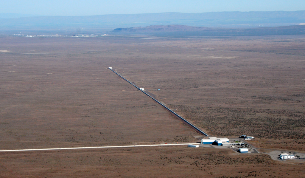 LIGO Observatory, in Hanford, WA. Visible are the two 4km arms containing vacuum chambers used to detect gravitational wave activity. (Courtesy: LIGO Laboratory)