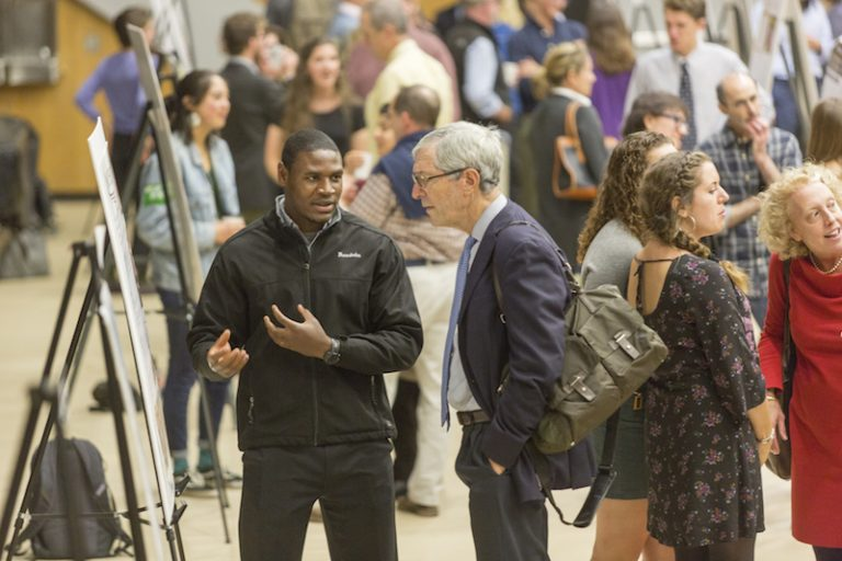 Student talking during 2017 President's Summer Research Symposium