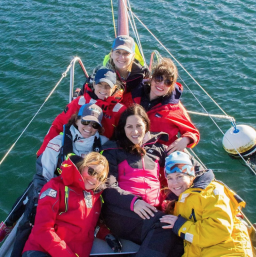 The Sail Like a Girl crew. Jeanne Assael Goussev '99 is in the center.