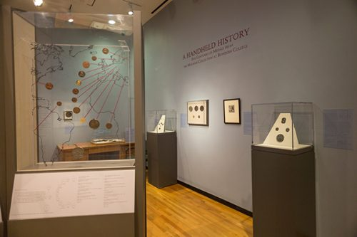 "Installation view of ""A Handheld History: Five Centuries of Medals from the Molinari Collection at Bowdoin College,"" on view at the Bowdoin College Museum of Art."