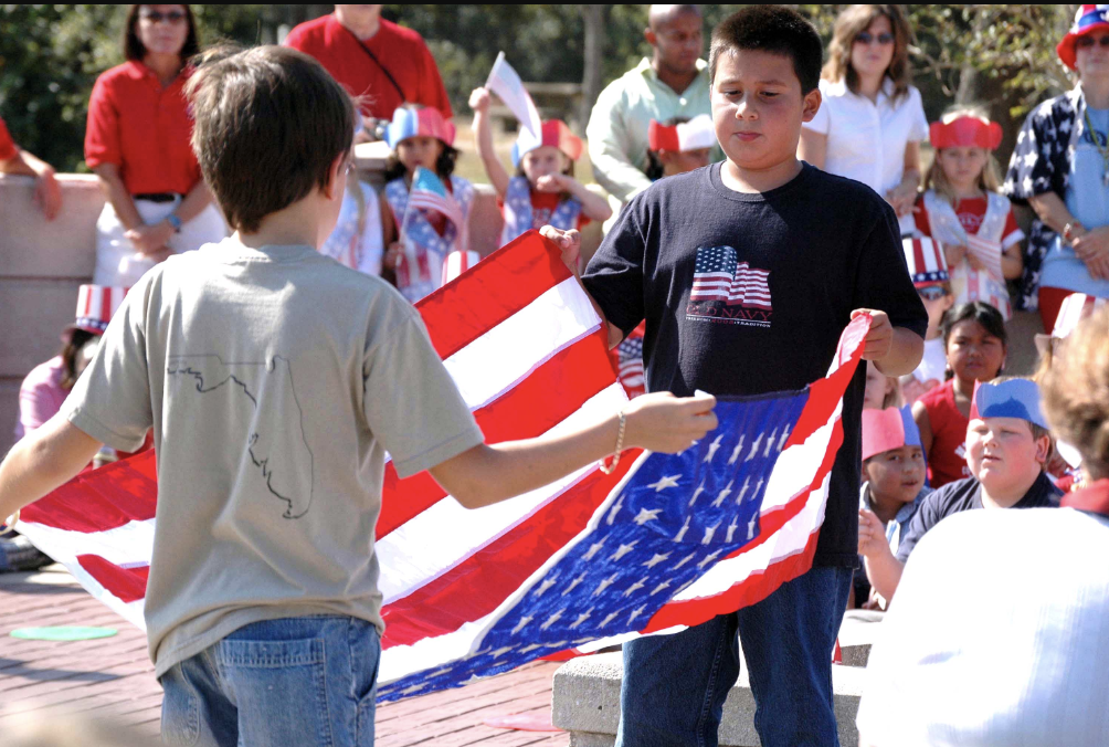 Students folding the US flag, photo courtesy of the US Government