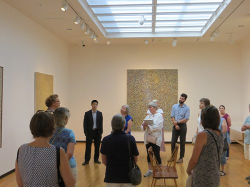 "Visitors enjoy the exhibition ""Richard Pousette-Dart: Painting/Light/Space"" at the Bowdoin College Museum of Art."