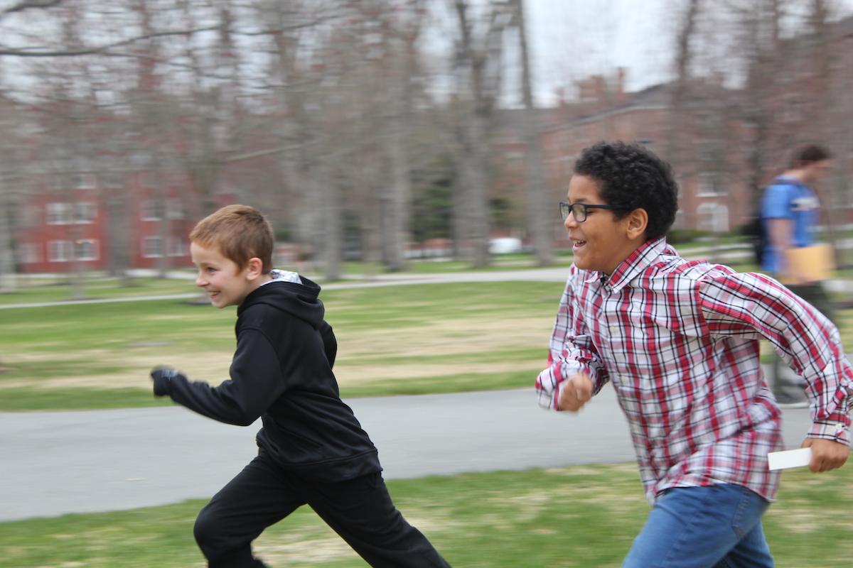 Kids leaving a campus building