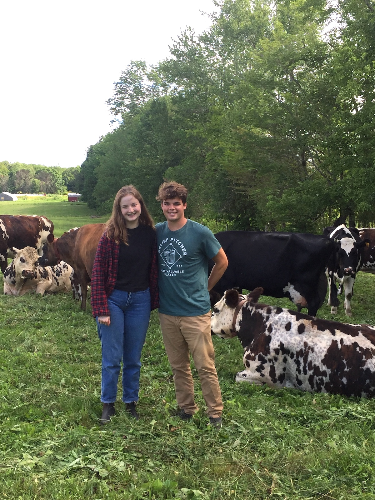 Eleanor Paasche and Cal Soule with dairy cows