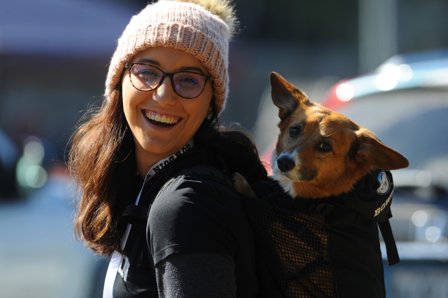 A woman with a dog in her backpack