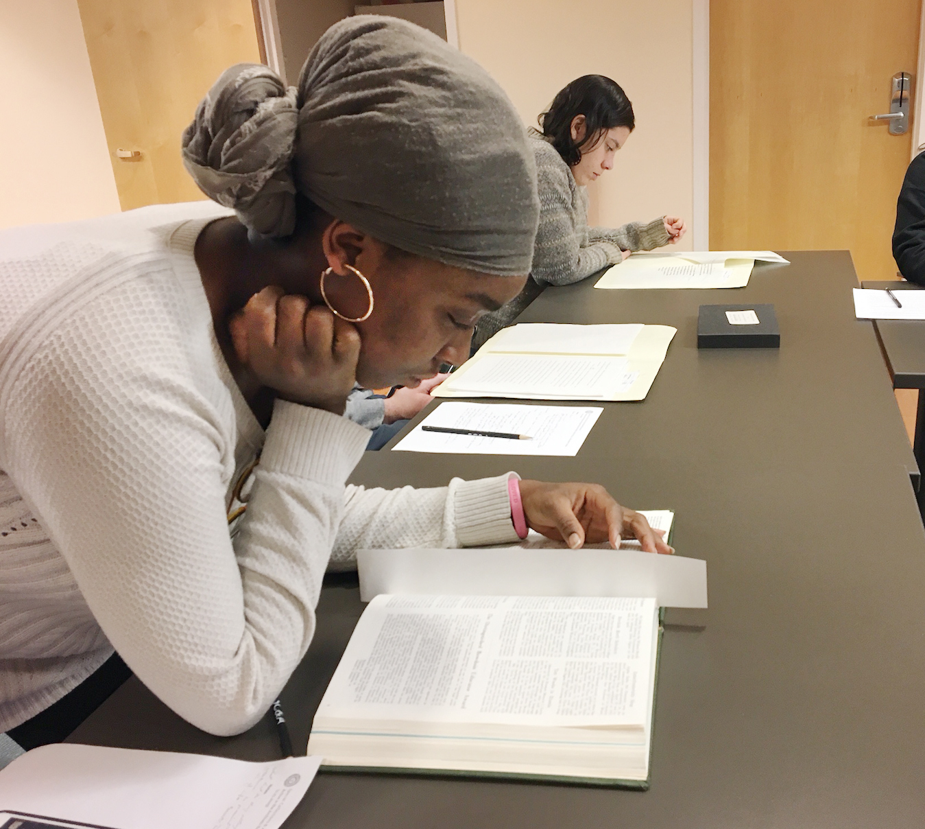 Oratile Monkhei reading about MLK's visit to Bowdoin
