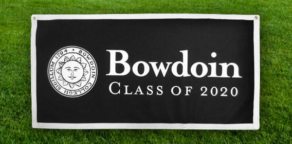 "A ""Bowdoin Class of 2020"" banner on the grass"