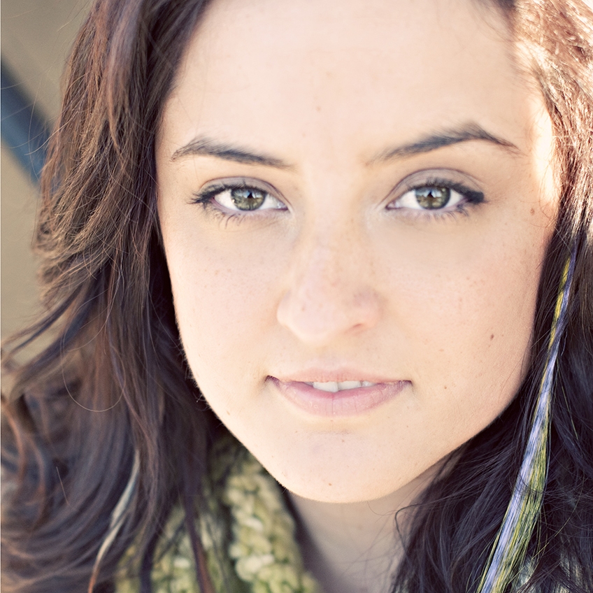 a headshot of Brenna Nicely