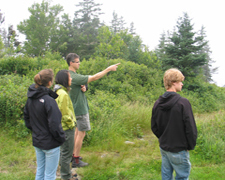 Logan and students discussing field work on Southport Island, Maine